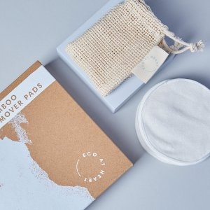 Plastic-free packaging for reusable bamboo make-up pads on blue background
